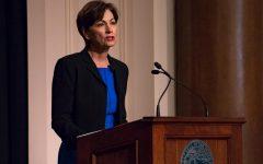 Photo Via Iowa Public Radio Images. Kim Reynolds speaking to her constituents in Iowa.