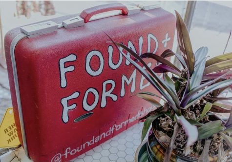 A suitcase painted with the Found + Formed logo. Courtesy of Found + Formed Instagram.