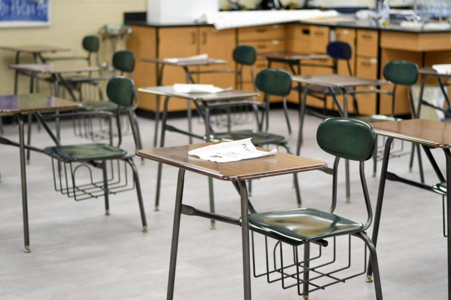 Desks%2C+spaced+out+to+ensure+social+distancing%2C+sit+empty.