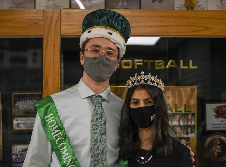 Last years homecoming King and Queen pose after their coronation.