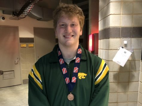 Cael Knox, sr., with 7th place medal from 2021 wrestling state competition.