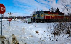 The train involved in the accident sits motionless on the tracks.