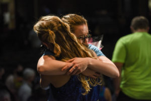 A Happiness performer embraces her relative after the show.