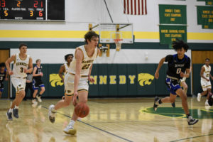 Caleb Schlaak dribbles down the court at a home game against Washington.
