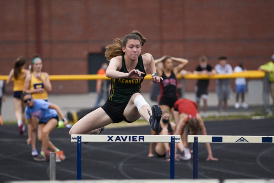 Molly Joyner, jr., jumps the hurdles during one of her events.