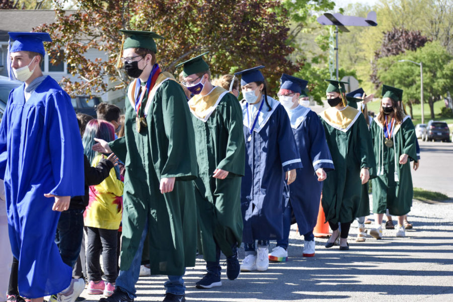 Graduates from Kennedy and Jeff give high fives to Jackson Elementary students during their Senior Walk