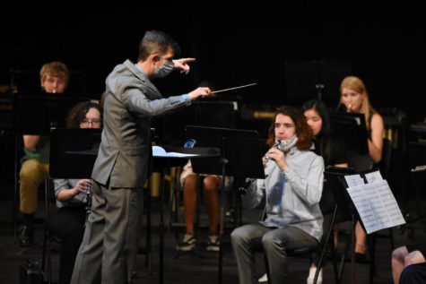Jared Wacker directs the Wind Symphony.