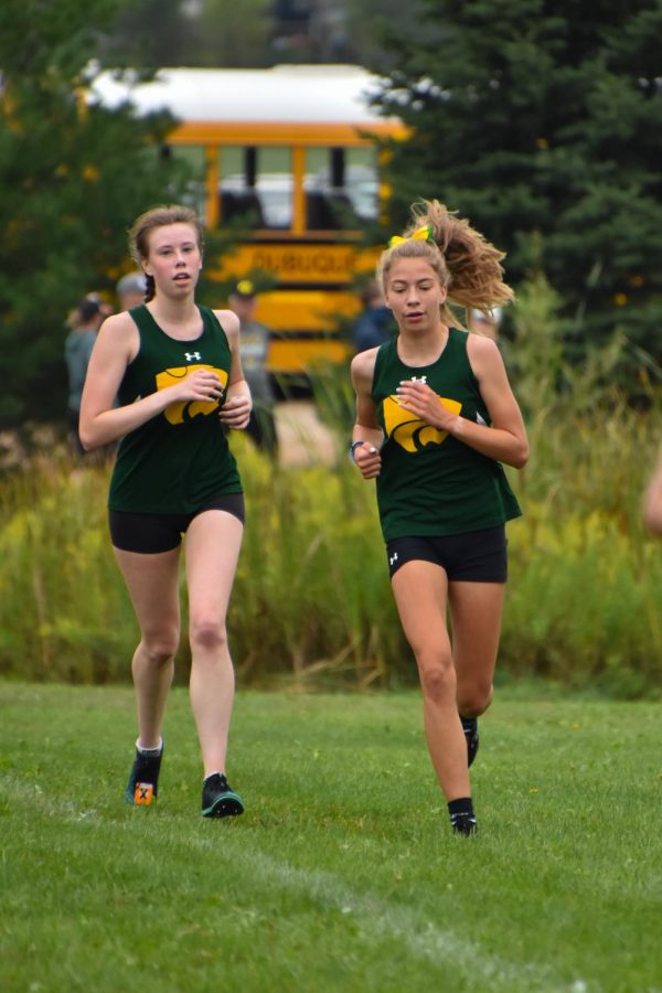 Senior Kayleigh Duncan and sophomore Alyssa Brandt run together for the cross country team at Oakridge.