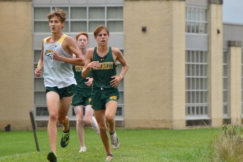 Miles Wilson looks to pass Dubuque Hempstead with Henry McMahan close behind.