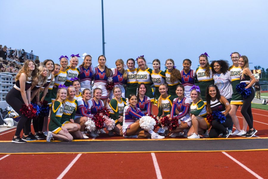 The Washington and Kennedy cheerleaders pose together before the game.