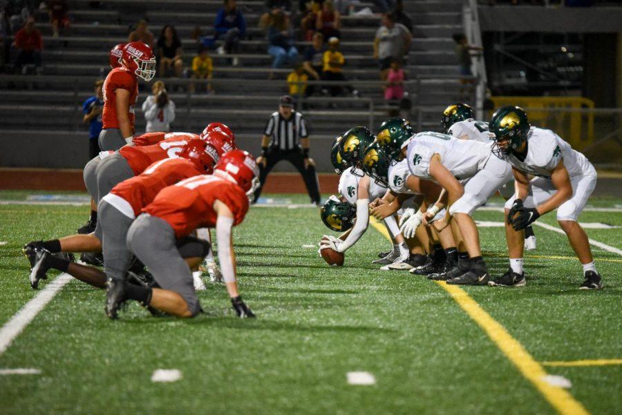 Photos: Varsity Football Defeats Washington