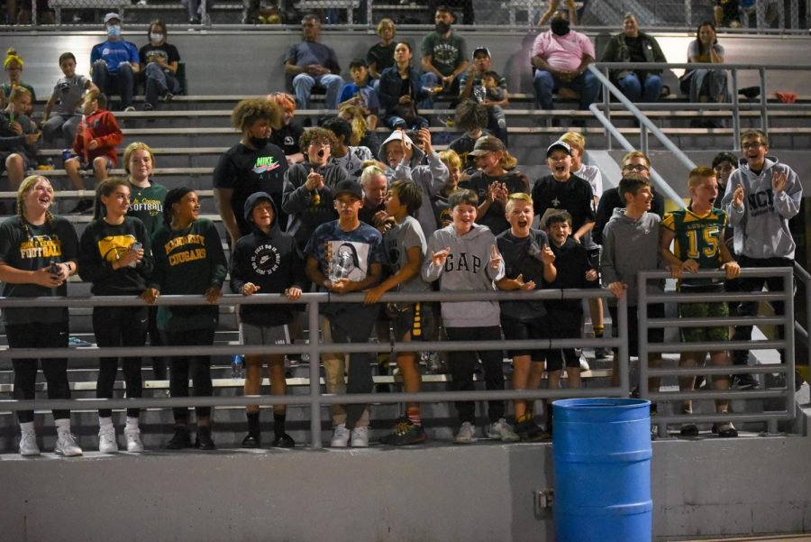 Middle school fans cheer on the football team.