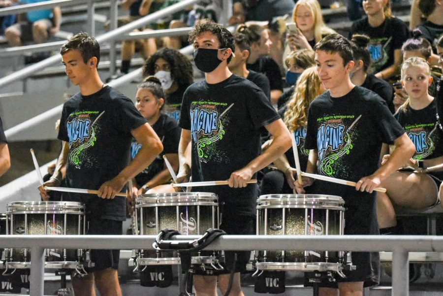 The Kennedy drumline plays in the stands during timeouts.