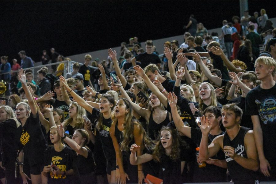 The Kennedy student section cheers after the 48-7 win.