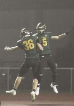 Colin Flannagan (#36) celebrates with wide receiver Jeron Senters (#5) after scoring a touchdown against Washington on September 10th, 2021